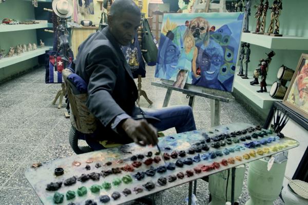 Un peintre à La Havane, calle Obispo